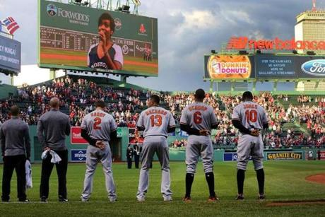 Boston-05/02/2017- Baltimore Orioles Adam Jones(far right) stands with teammates during the singing of the national anthem Tuesday night at Fenway Park before the game against the Red Sox.John Tlumacki/Globe Staff (sports)