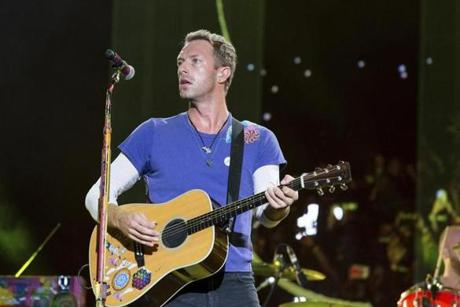"FILE - In this Sept. 4, 2016 file photo, Chris Martin of Coldplay performs at The Budweiser Made In America Festival in Philadelphia. Coldplay will join Ariana Grande at a charity concert called ""One Love Manchester"" in Manchester, England, Sunday, June 3, 2017, two weeks after a bomber killed 22 people at Grande's concert in Manchester. (Photo by Michael Zorn/Invision/AP, File)"