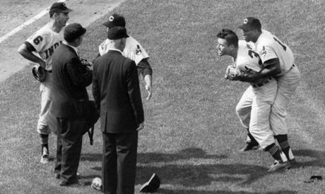 Boston, MA - 7/23/1960: Cleveland Indians' Vic Power has to hold back teammate Jim Piersall, at right. after Piersall was ejected for distracting Red Sox batter Ted Williams in the eighth inning during a game at Fenway Park in Boston on Jul. 23, 1960. At left, Johnny Temple (16) and manager Joe Gordon confer with umpires Ed Hurley and John Flaherty. (Gil Friedberg/Globe Staff) --- BGPA Reference: 170213_BS_001