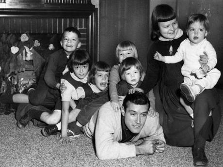 Newton, MA - 12/9/1960: Baseball player Jim Piersall spends the holiday season at home with his children, from left, Jimmy, 6; Doreen, 8; Claire, 7; Maura-Ann, 4 1/2; Kathleen, 3; Eileen, 9; and Ann, 1 1/2, in Newton, MA on Dec. 19, 1960. (Gil Friedberg/Globe Staff) --- BGPA Reference: 170213_BS_009