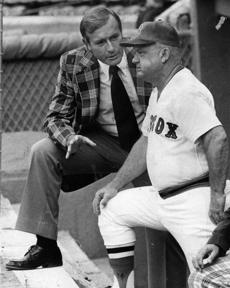 Boston, MA - 6/14/1977: Broadcaster and former Red Sox player Jim Piersall talks with Red Sox manager Don Zimmer before a game against the Chicago White Sox at Fenway Park in Boston on Jun. 14, 1977. (Frank O'Brien/Globe Staff) --- BGPA Reference: 170213_BS_016