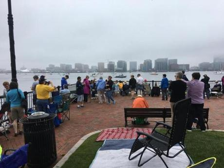 The foggy view of Boston at Piers Park in East Boston.