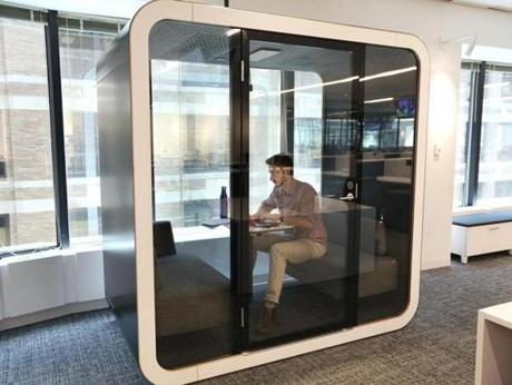 The newsroom includes soundproof booths for sensitive phone calls.