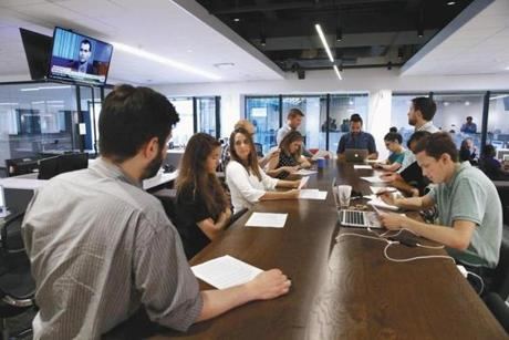 Members of Boston.com took part in their daily standup meeting.