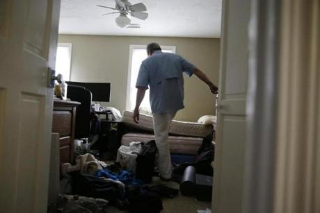 Russell Reeves walked through a second bedroom that was used by his son.