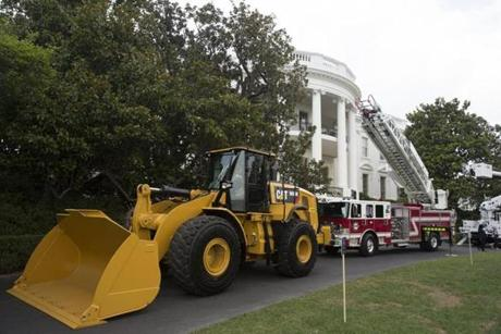 epa06093227 A wheel loader and firetruck are among the items on display at a showcase of products made in the United States, at the South Lawn of the White House, in Washington, DC, USA, 17 July 2017. US President Donald J. Trump will participate at the White House in a showcase of products 'Made in America'. EPA/MICHAEL REYNOLDS