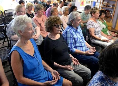 Quincy 07/19/2017: People close their eyes with their hands on their laps and palms facing up during Tom Tam's Healing class at the Oriental Culture Institute in Quincy. Photo by Debee Tlumacki for the Boston Globe (south)