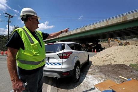 Hanover, MA - 8/01/2017 - Manny Aguiar, Resident Engineer, Mass DOT points out one of the bridges over Webster street in Hanover that will be replaced. The State Department of Transportation is undertaking a $30 million project to replace four structurally deficient bridges that carry Route 3 over High Street in Norwell and over Route 123 (Webster Street) in Hanover. - (Barry Chin/Globe Staff), Section: Regional/South Week, Reporter: John Laidler, Topic: 13soroadwork, LOID: 8.3.3256216822.
