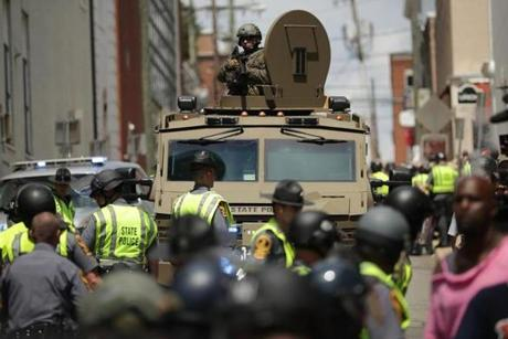 A Virginia State Police officer in riot gear kept watch from the top of an armored vehicle after the car plowed through a crowd of counterdemonstrators.