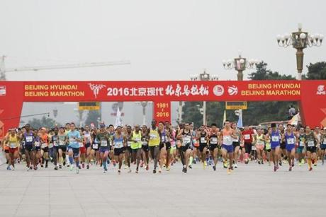 """Sports sets the stage for a stronger and more prosperous country,"" said President Xi Jingping. Above: competitors started the 2016 Beijing marathon."
