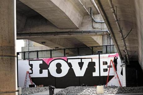 "Artist Cey Adams worked on LOVE at ""Ink Underground,"" a park being designed under the Southeast Expressway in the South Ennd."