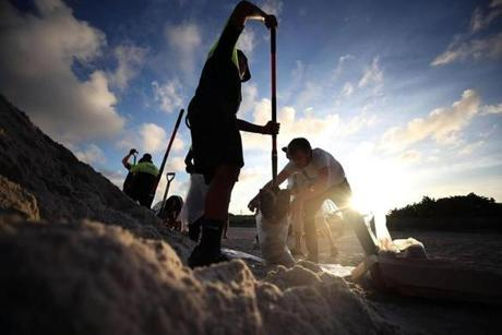 MIAMI BEACH, FL - SEPTEMBER 07: Park officials fill sand bags for residents who are preparing for approaching Hurricane Irma on September 7, 2016 in Miami Beach, Florida. Current tracks for Hurricane Irma shows that it could hit south Florida this weekend. (Photo by Mark Wilson/Getty Images)