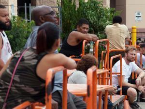Customers wait in line at a Home Depot store ahead of Hurricane Irma in Miami on Sept. 6, 2017. MUST CREDIT: Bloomberg photo by Jayme Gershen.