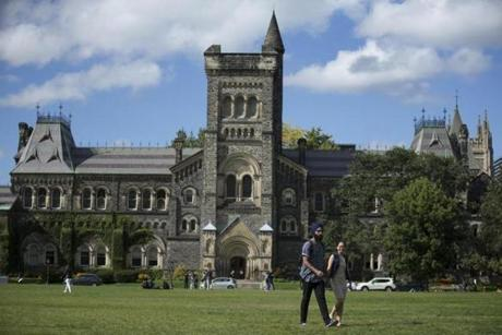 Students walked across the lawn in front of the university's King's College.