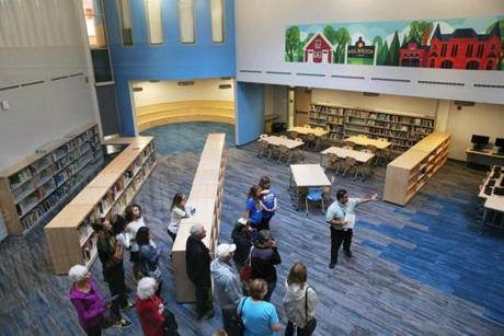 Jorge Gonzalez, IT Director, leads a tour through the media center at the Holbrook PreK-12 Complex