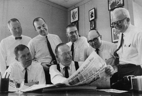 "Celebrating The Boston Globe's first Pulitzer Prize in 1966 were, from left (front row): Bob Healy, Washington bureau chief; Tom Winship, editor; (back row) reporters Joseph M Harvey; Martin Nolan; Anson ""Bud"" Smith; Richard Connolly; and editorial page editor Charles Whipple."