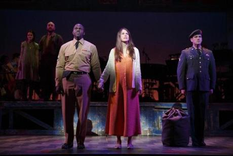 "(Front, from left) Joshua Henry, Sutton Foster, and Colin Donnell in a scene from ""Violet."""